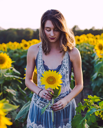 woman holding sunflower 350px